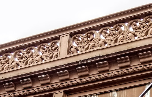 Arabesque frieze and bracketed cornice detail