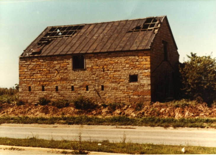 The barn in the 1970s in its original location before relocation and restoration