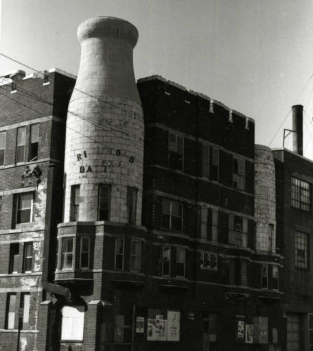 This most unique building of the District combines Gothic architecture with giant milk bottles. Circa 1978
