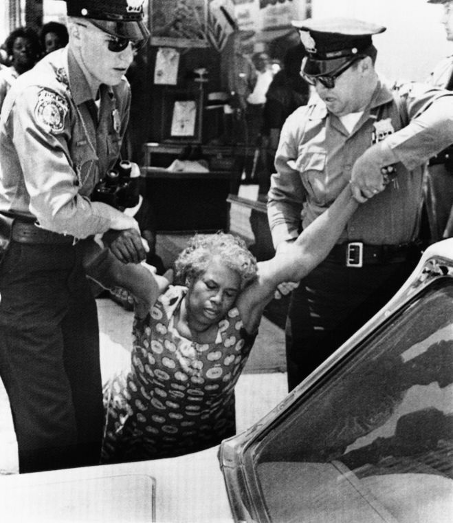 An unidentified woman is carried by Danville police.
