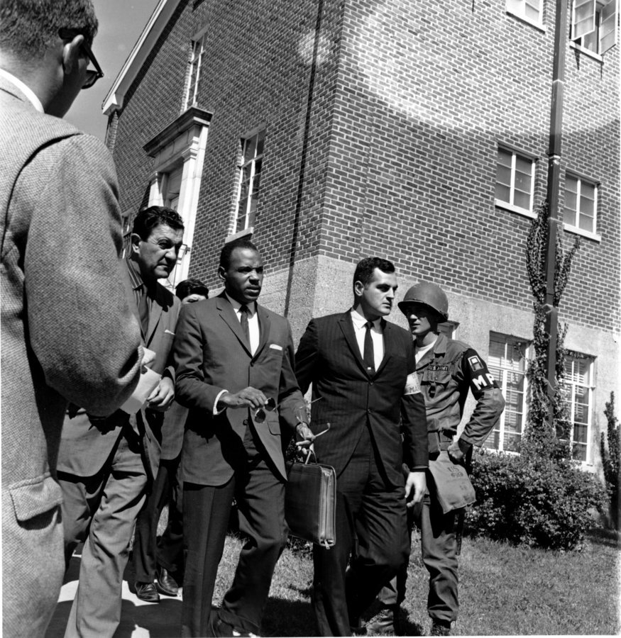 James Meredith flanked by federal Marshals in 1962