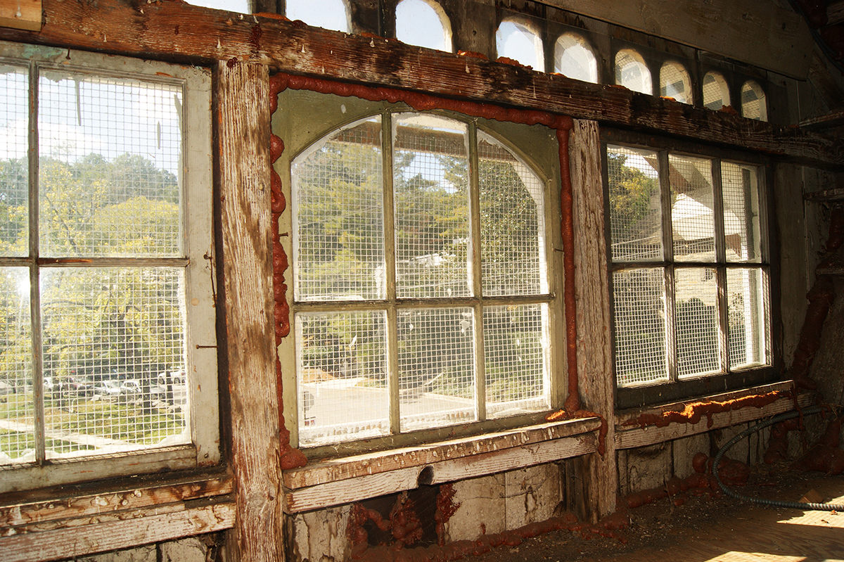 Looking through the grated windows of the former spy station, by Elliot Carter on Atlas Obscura (reproduced under Fair Use)