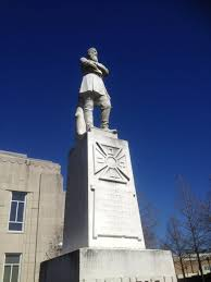 This image portrays the very large statue of General Alfred Mouton that stands in front of the old courthouse within Lafayette, LA. It has been attempted removal several times, but still stands today. The statue is still a very strong frame showing that the lost cause is still alive within the south and seems to be going nowhere without the removal of the statue.