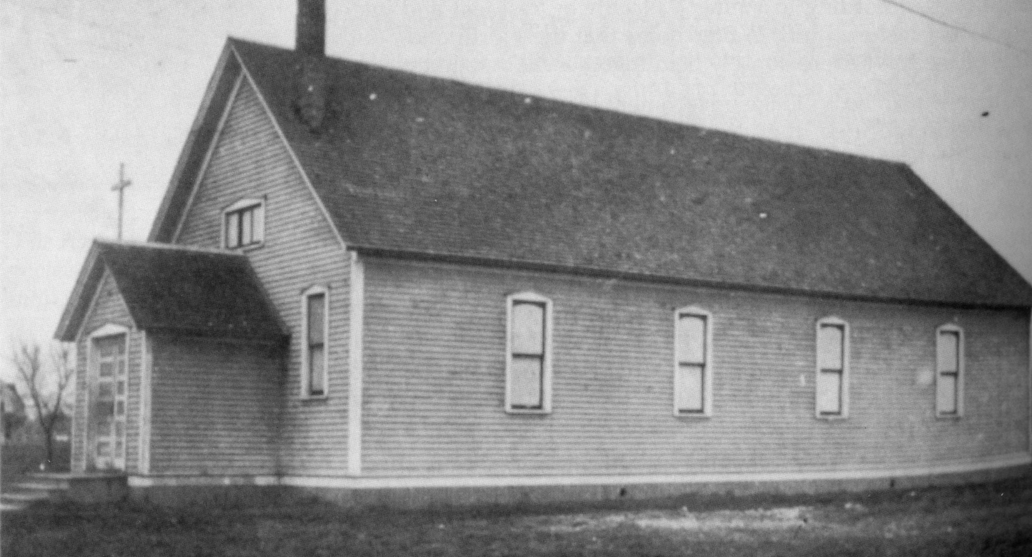 The original frame church constructed in 1903.