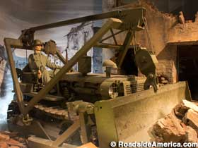 Exhibit of an Army Engineer bulldozing rubble