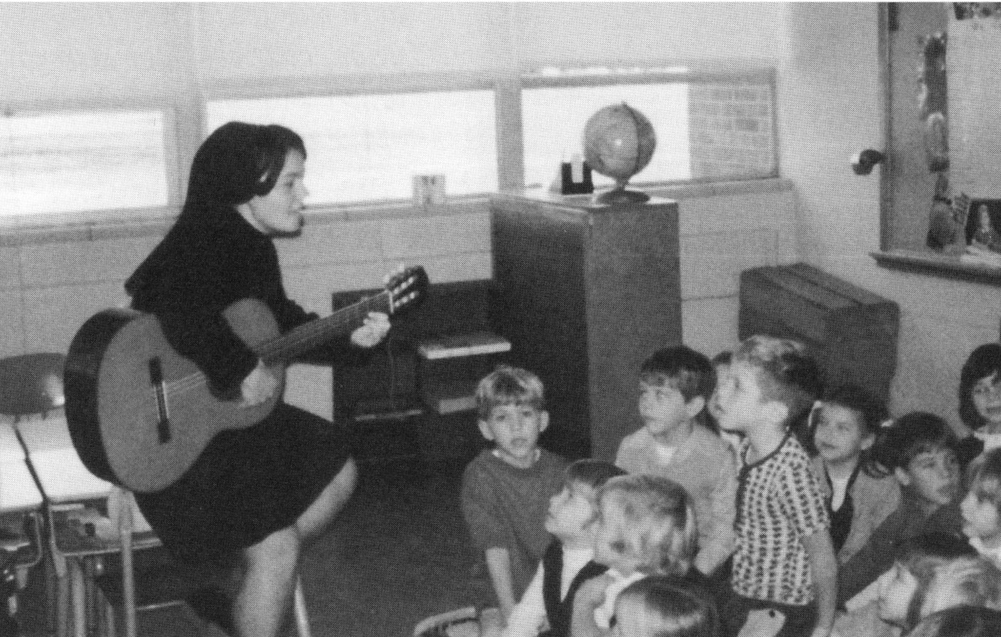 Sister Clare Lawlor sings to her students at Presentation School, 1970s.