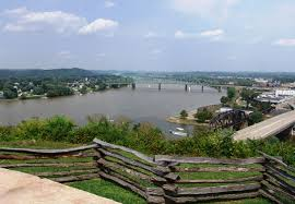 The view of the Ohio River from atop Fort Boreman, which was situated to take advantage of the ridge's commanding heights. In the foreground are recreated breastworks from the Union fort.