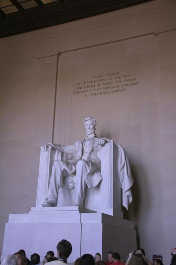 Designed by Daniel Chester French and carved by the Piccirilli Brothers, the statue of Abraham Lincoln is an iconic part of the memorial. It depicts his left hand clenched in strength and his right hand relaxed in peace.