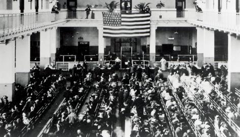 The Great Hall where immigrants were processed. The flags feature 46 stars and were used for four years (July 4, 1908 – July 3, 1912). The flags are still hanging in the museum.