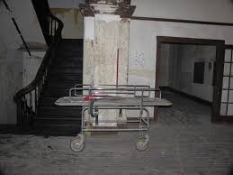 An abandoned gurney in the asylum, left to rot in the abandoned hallways