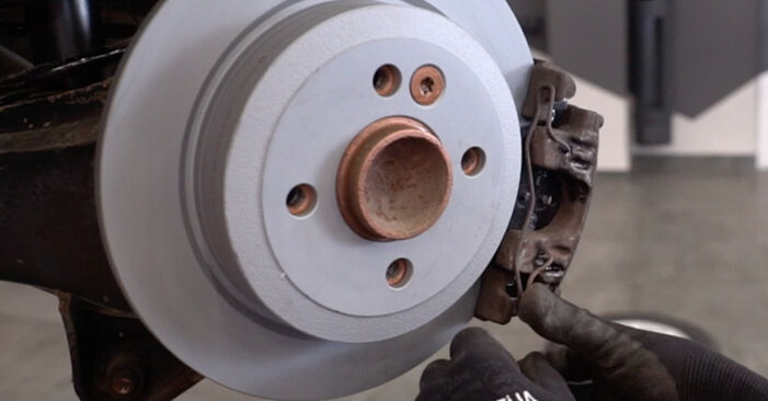 Changing Brake Pads on MINI Hatchback (R50, R53) 1.4 D One 2004 by yourself