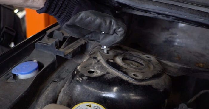 Changing of Strut Mount on Ford Focus mk2 Saloon 2012 won't be an issue if you follow this illustrated step-by-step guide