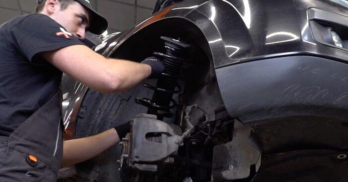 Jak trudno jest to zrobić samemu: wymień Poduszka Amortyzatora w Ford Focus mk2 Sedan 1.4 2010 - pobierz ilustrowany przewodnik