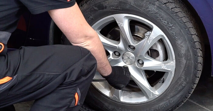 How to remove PEUGEOT 208 1.0 2016 Brake Discs - online easy-to-follow instructions