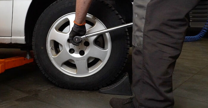 How to remove OPEL ZAFIRA 2.2 16V (F75) 2003 Brake Discs - online easy-to-follow instructions