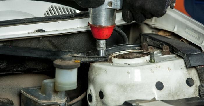 Recommandations étape par étape pour remplacer soi-même Toyota Rav4 II 2001 2.4 4WD Coupelle d'Amortisseur