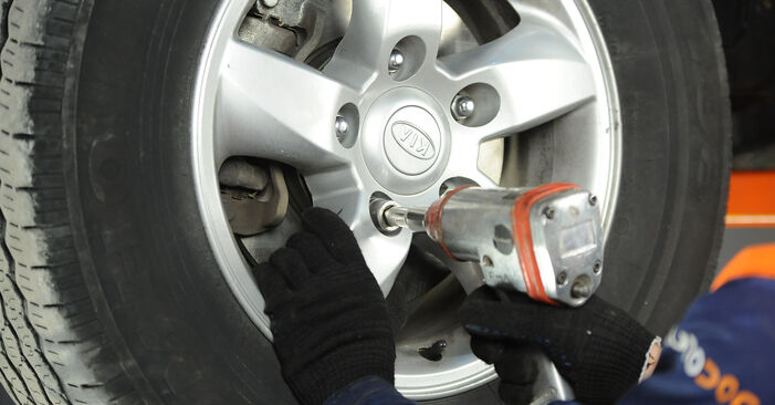 Changing Brake Pads on KIA SORENTO I (JC) 3.3 V6 2005 by yourself