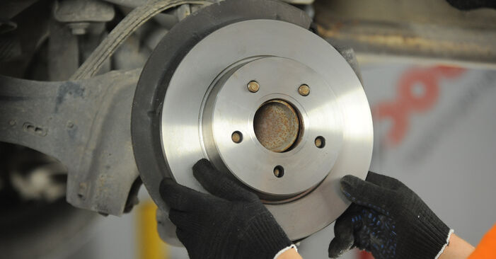 How to replace FORD Focus II Saloon (DB_, FCH, DH) 1.6 TDCi 2005 Brake Discs - step-by-step manuals and video guides