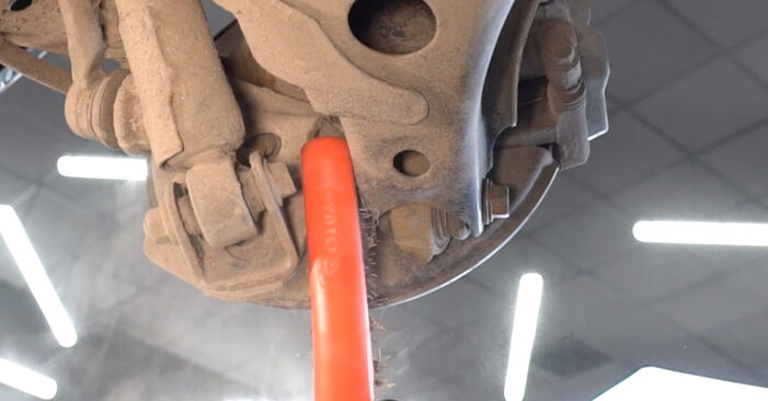 How to remove TOYOTA YARIS 1.5 (NCP13_) 2003 Shock Absorber - online easy-to-follow instructions