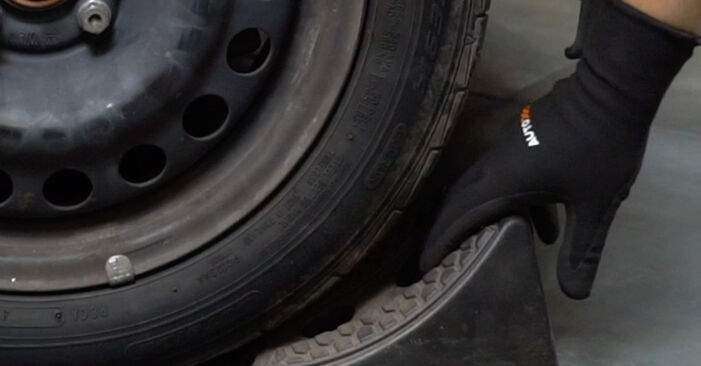 How to remove NISSAN MICRA 1.0 1996 Strut Mount - online easy-to-follow instructions