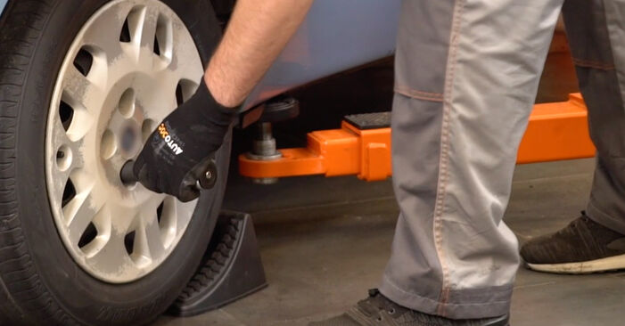 Steg-för-steg-rekommendationer för att byta Fiat Punto 188 2012 1.9 JTD Fjädrar på egen hand