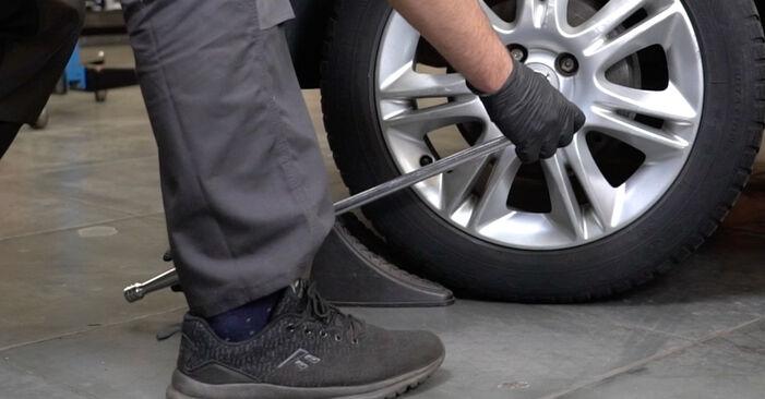 Kaip pakeisti OPEL Corsa D Hatchback (S07) 1.3 CDTI (L08, L68) 2007 Spyruoklės - išsamios instrukcijos ir vaizdo pamokos