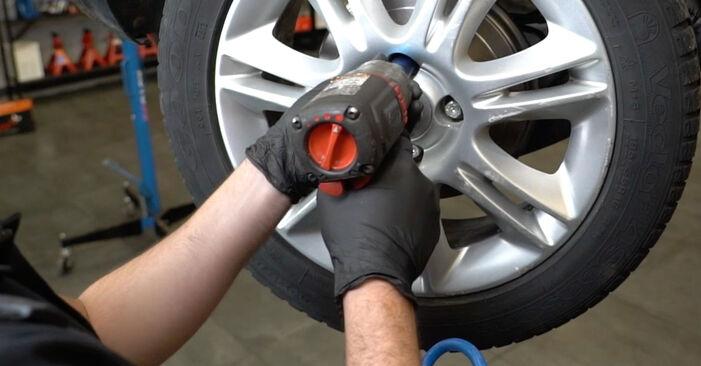 Hvordan skifte Støtdemper på OPEL Corsa D Hatchback (S07) 2011: Last ned PDF- og videoveiledninger