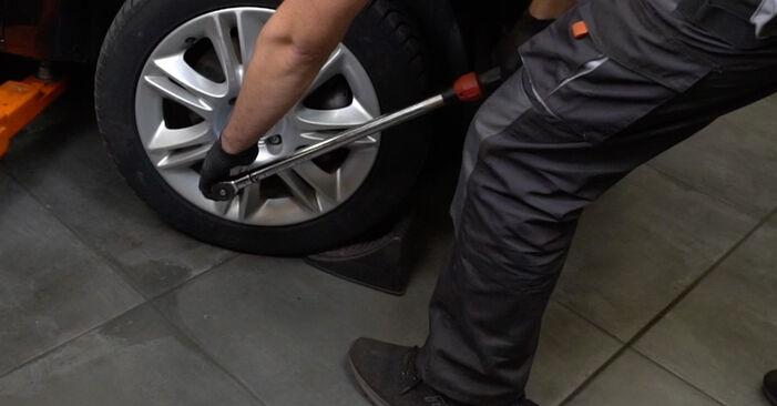 Hvordan man udskifter OPEL Corsa D Hatchback (S07) 1.3 CDTI (L08, L68) 2007 Fjeder - trin-for-trin manualer og video vejledninger