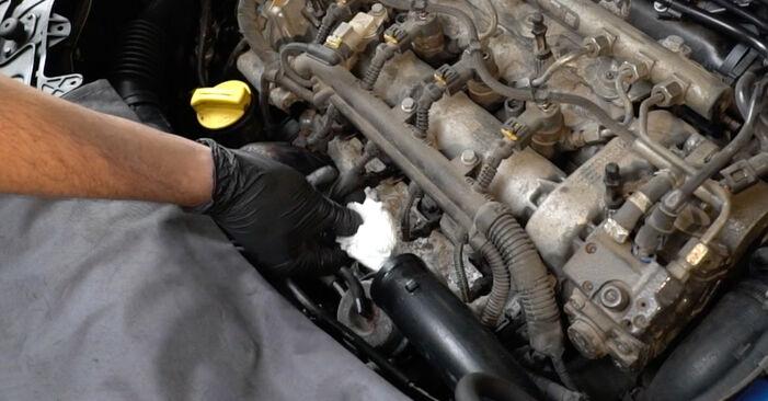 Hvordan skifte Oljefilter på Opel Corsa D 2006 – gratis PDF- og videoveiledninger