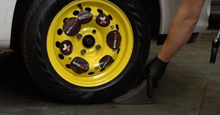 Substituição de Renault Clio 3 1.2 16V 2007 Discos de Travão: manuais gratuitos de oficina