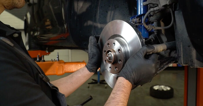 How to remove OPEL CORSA 1.3 CDTI (L08, L68) 2010 Brake Discs - online easy-to-follow instructions