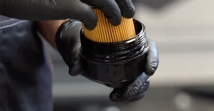 How to replace OPEL Astra G CC (T98) 1.6 16V (F08, F48) 1999 Oil Filter - step-by-step manuals and video guides