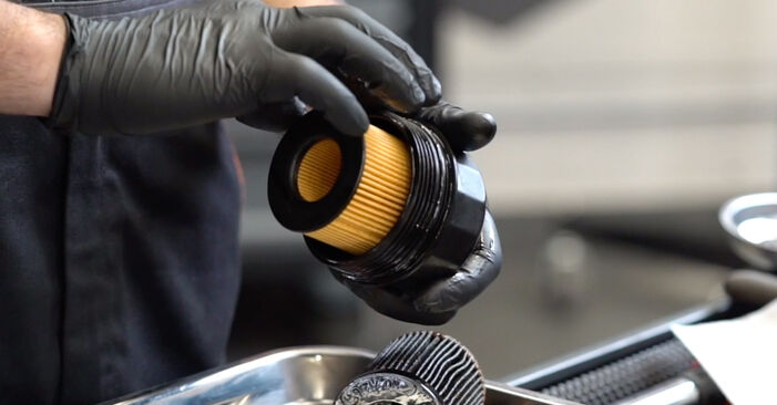 Changing Oil Filter on OPEL Astra G CC (T98) 2.0 DTI 16V (F08, F48) 2001 by yourself