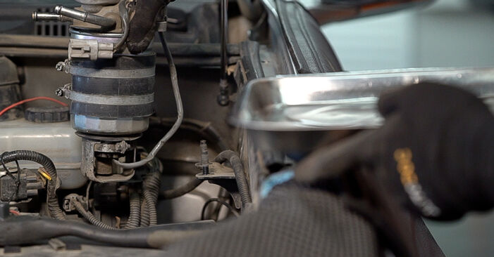 How hard is it to do yourself: Fuel Filter replacement on Toyota Prado J120 3.0 D 2001 - download illustrated guide