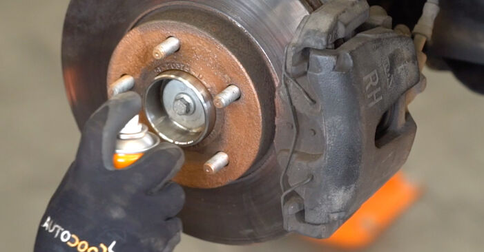 Sustitución de Muelles de Suspensión en un Ford Focus mk2 Berlina 1.8 TDCi 2006: manuales de taller gratuitos