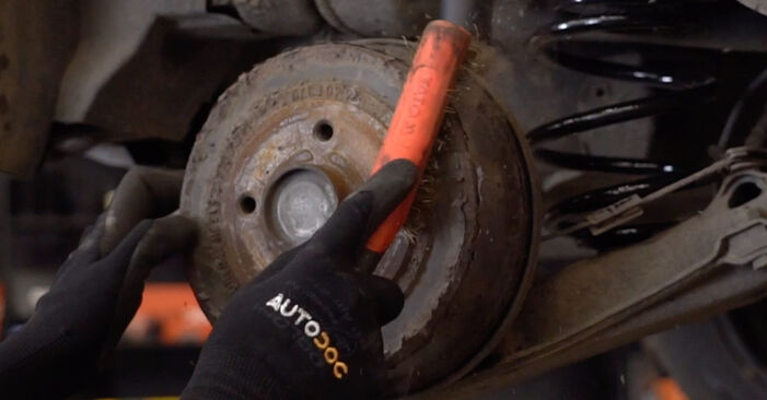 How to change Shock Absorber on OPEL Corsa C Hatchback (X01) 2002 - tips and tricks