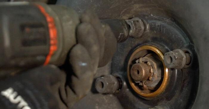 Schimbare Opel Corsa C 1.0 (F08, F68) 2002 Arc spirala: manualele de atelier gratuite