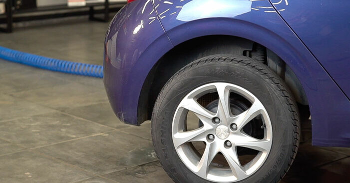 Peugeot 208 1 1.2 2014 Molla Ammortizzatore sostituzione: manuali dell'autofficina