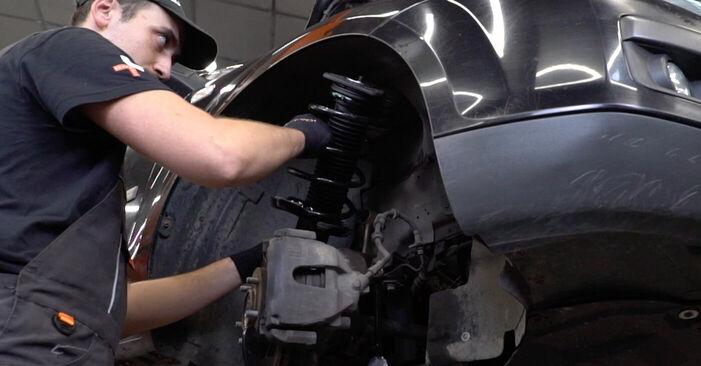 Не е трудно да го направим сами: смяна на Тампон Макферсон на Ford Focus mk2 Седан 1.4 2010 - свали илюстрирано ръководство