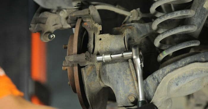 How to change Brake Discs on FORD Focus II Hatchback (DA_, HCP, DP) 2007 - tips and tricks
