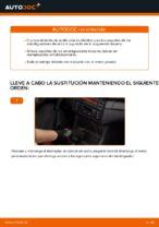 Cómo reemplazar el soporte de amortiguador trasero en un BMW E46 Cabrio