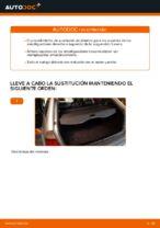 Cómo reemplazar el soporte de amortiguador trasero en un BMW E46 Touring