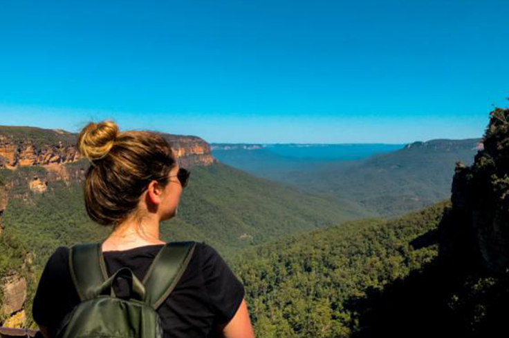 Girl looking out to scenic view of Blue Mountains, Sydney