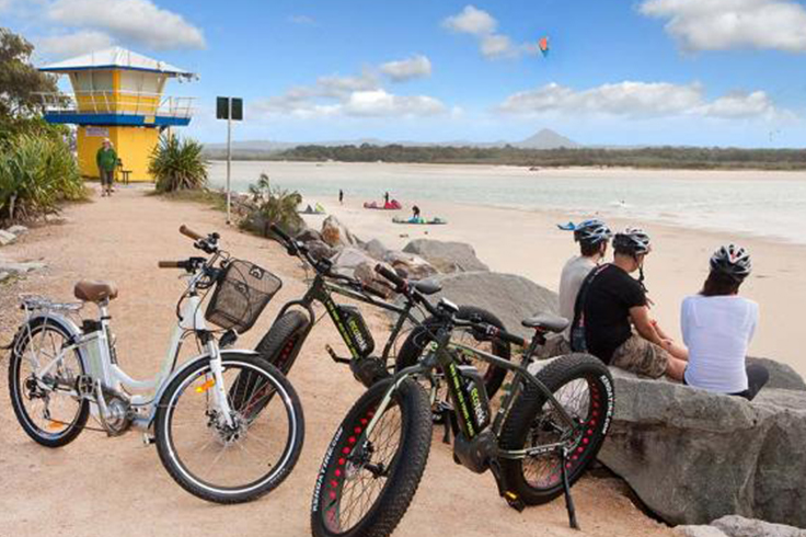 tourists visiting noosa on electric bikes with eco trek