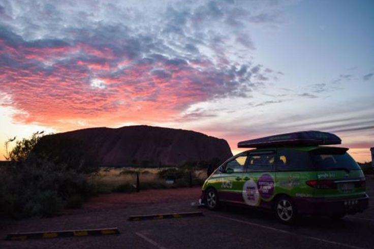 jucy camper parked near uluru national park at sunrise