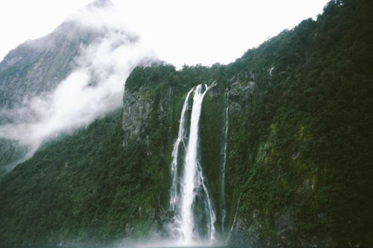 dramatic and cloudy waterfall