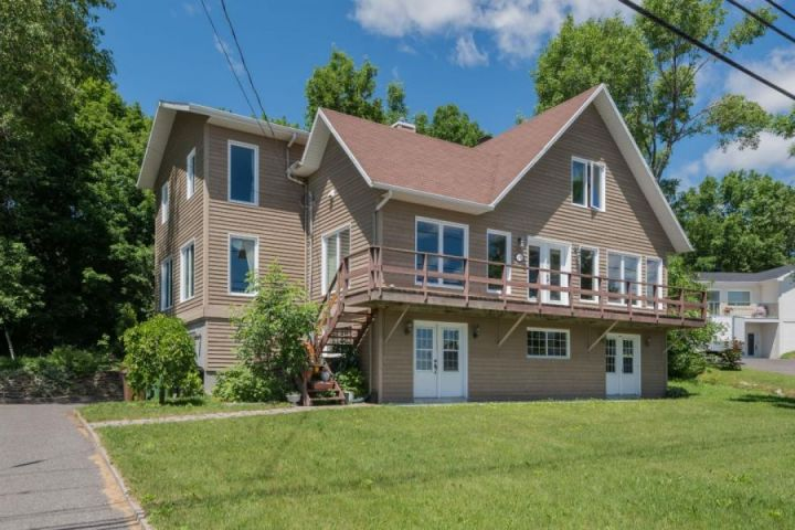 The River View of This Renovated Neuville House Will Steal Your Heart!