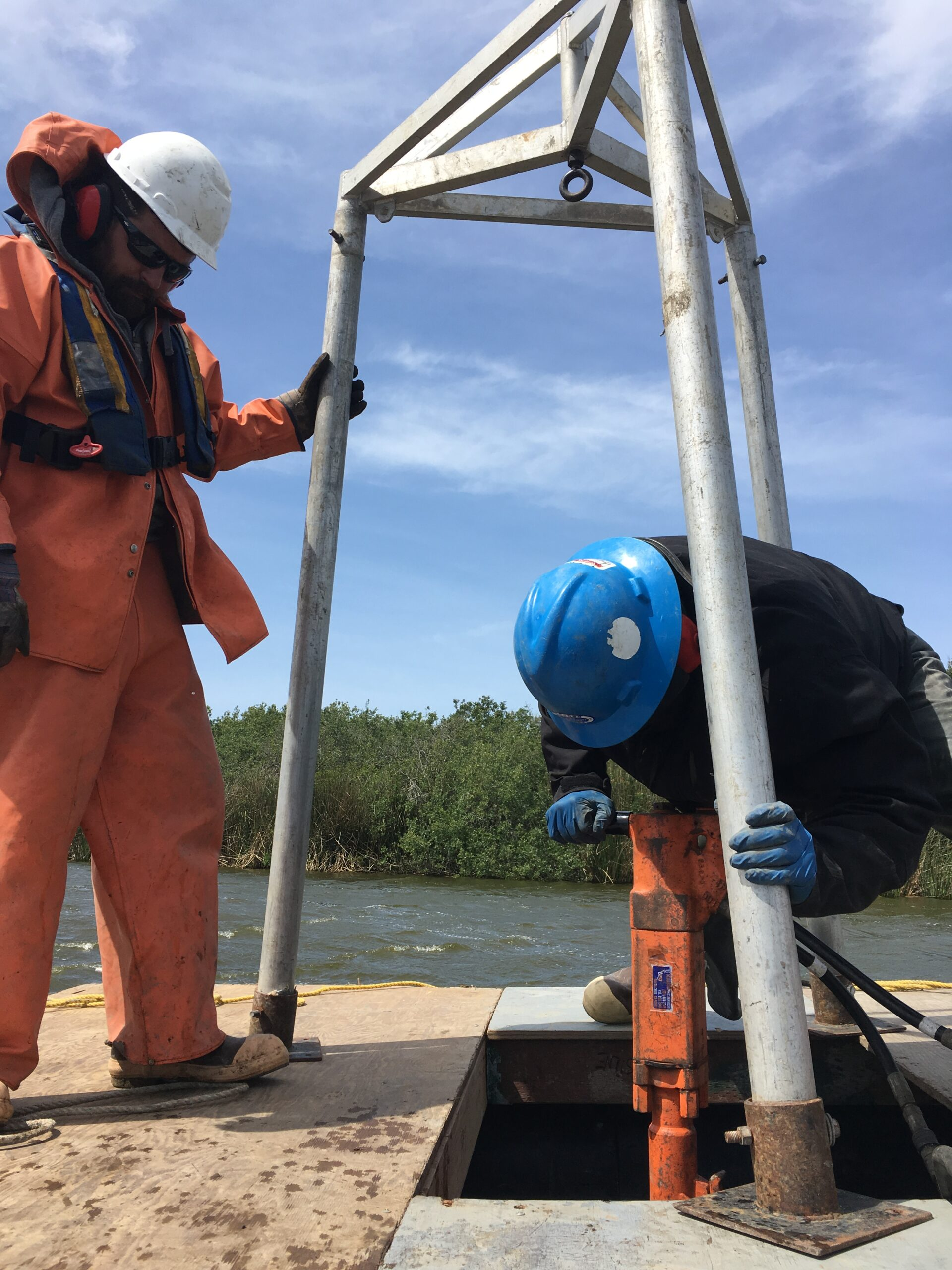 Extracting core samples of Oso Flaco Lake sediment