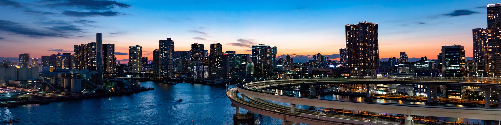 panoramic image of a city at sunset