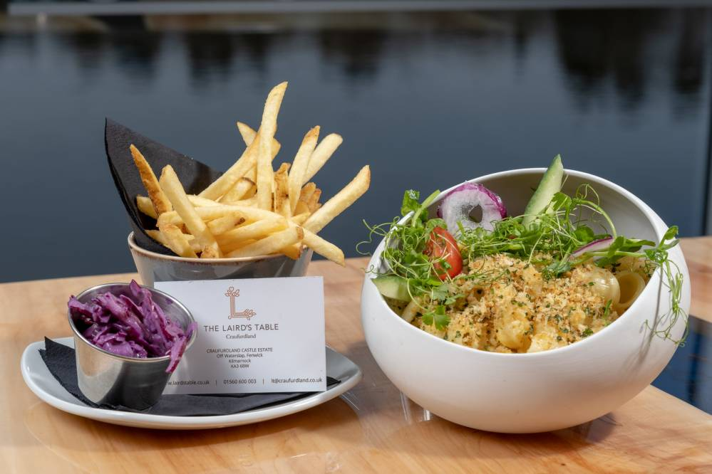 Baked Macaroni  Glazed with Scottish cheddar & topped with a garlic and herb crumb, and served with our skinny fries.